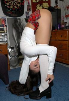 Young brunette schoolgirl wearing only..
