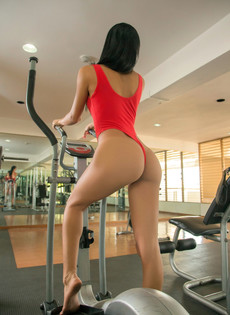 Young Asians in bright red leotard..