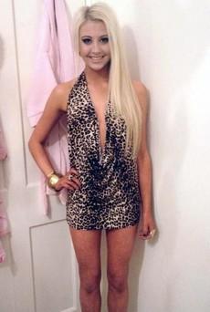 Elegant blonde in a beautiful dress..