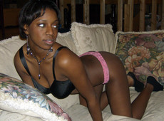Tempting black girl posing in lingerie..